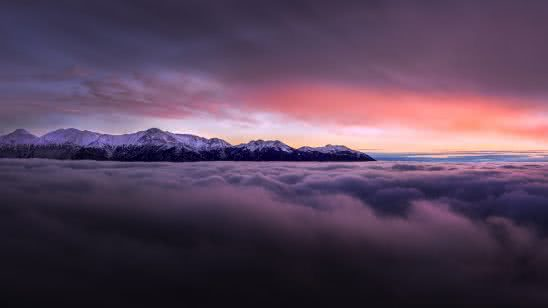 sunset with mountains above clouds uhd 8k wallpaper
