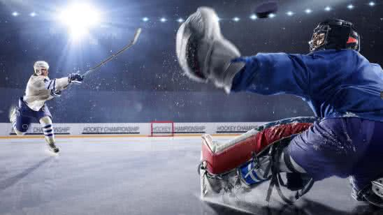 hockey player shooting puck at goalie uhd 8k wallpaper