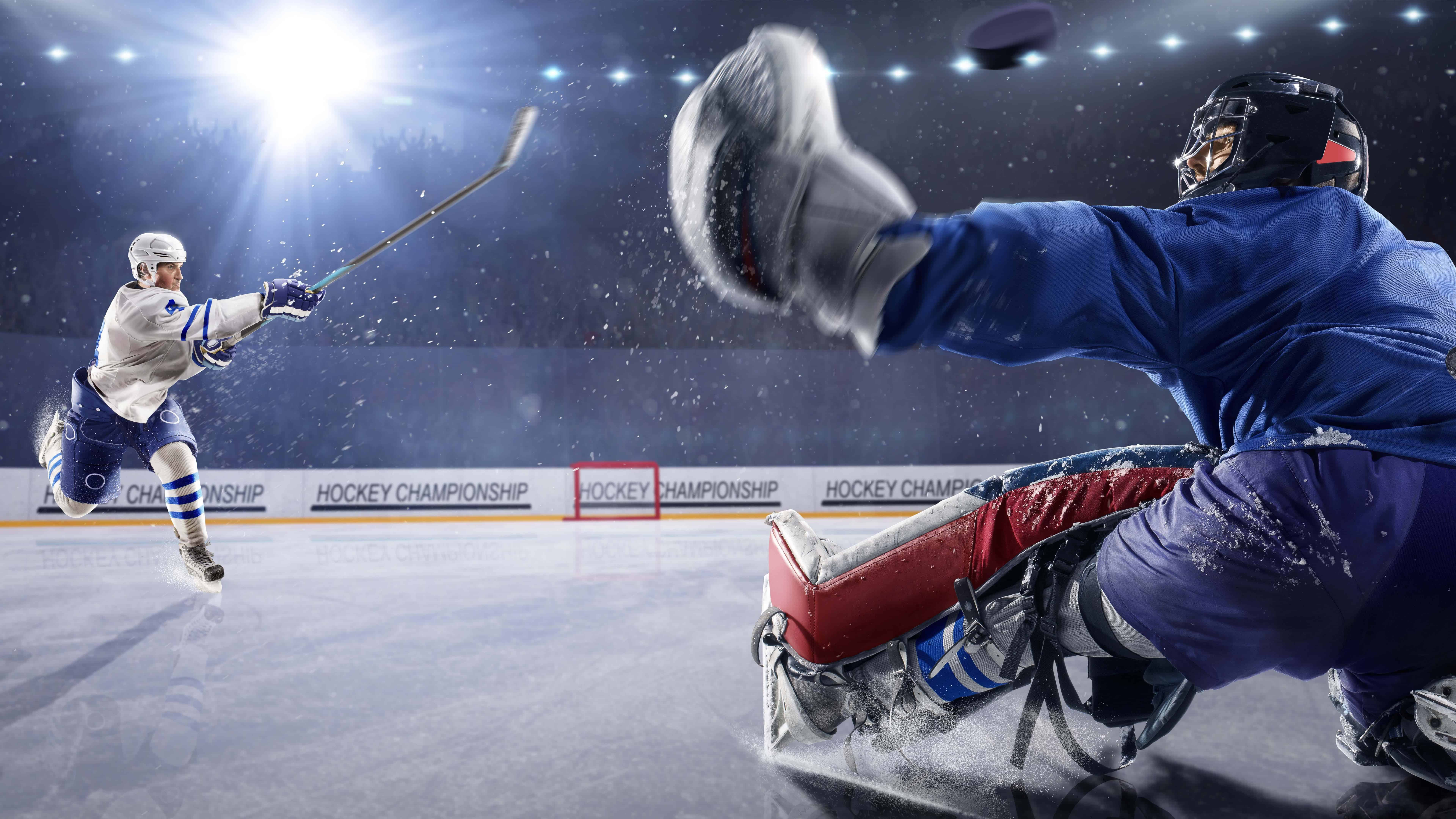 hockey player shooting puck at goalie uhd 8k wallpaper
