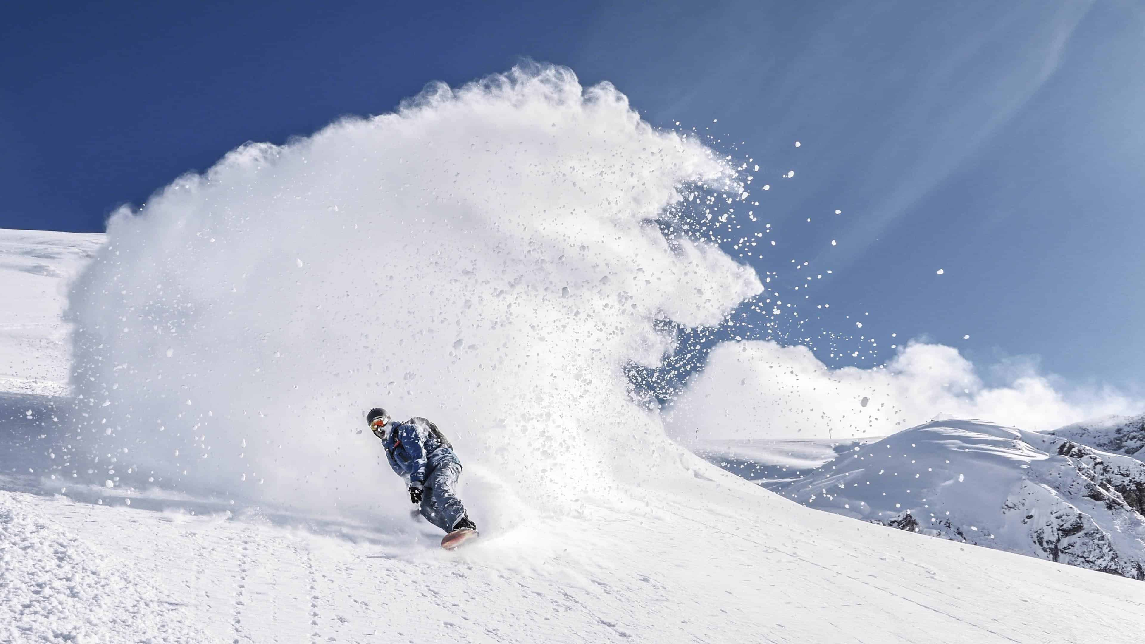 snowboarding in fresh powder uhd 4k wallpaper