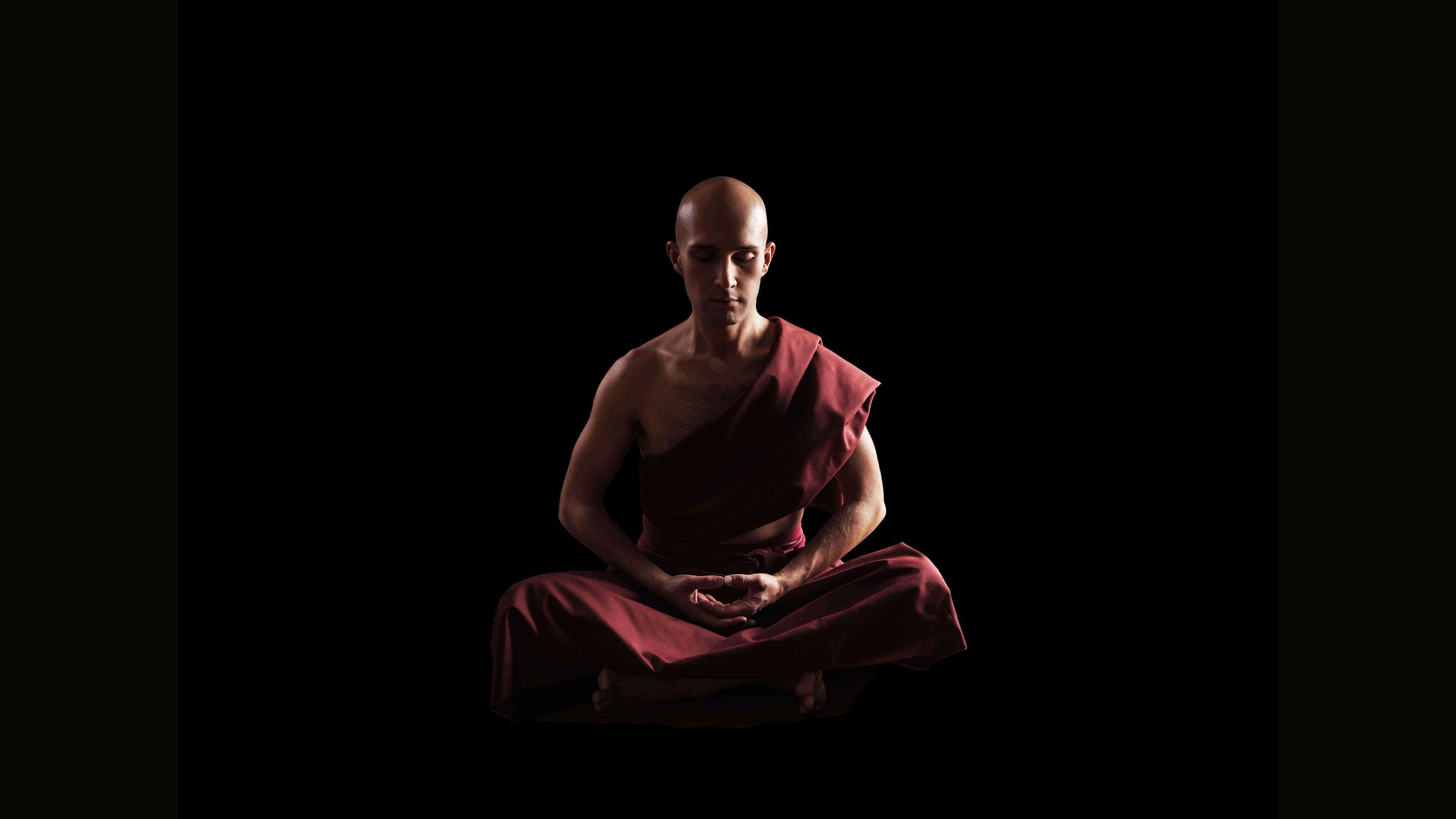 buddhist monk meditating uhd 4k wallpaper