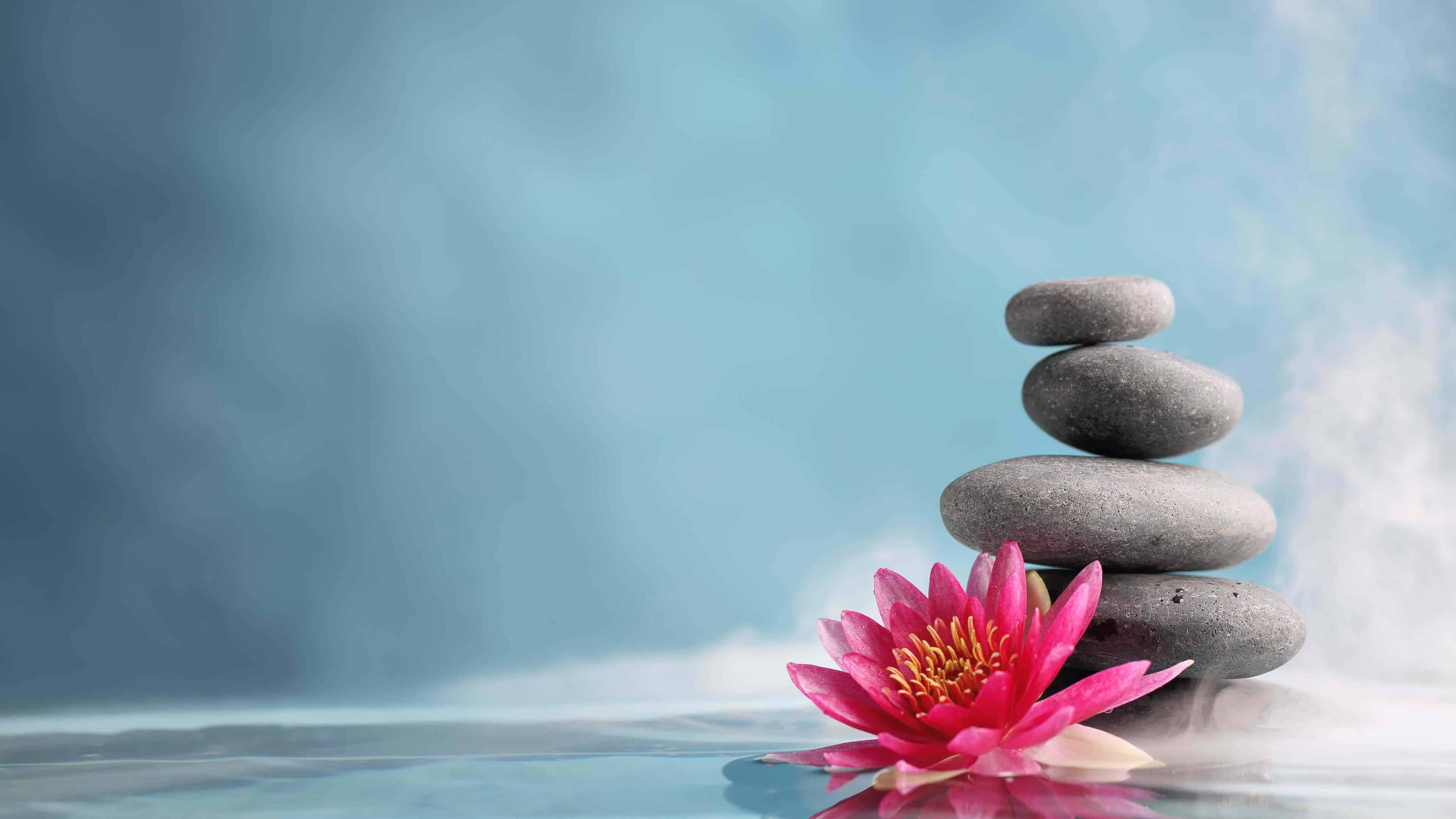 stacked massage stones and lotus uhd 4k wallpaper