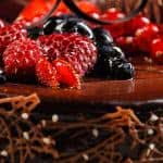 chocolate cake topped with fruits dual monitor wallpaper