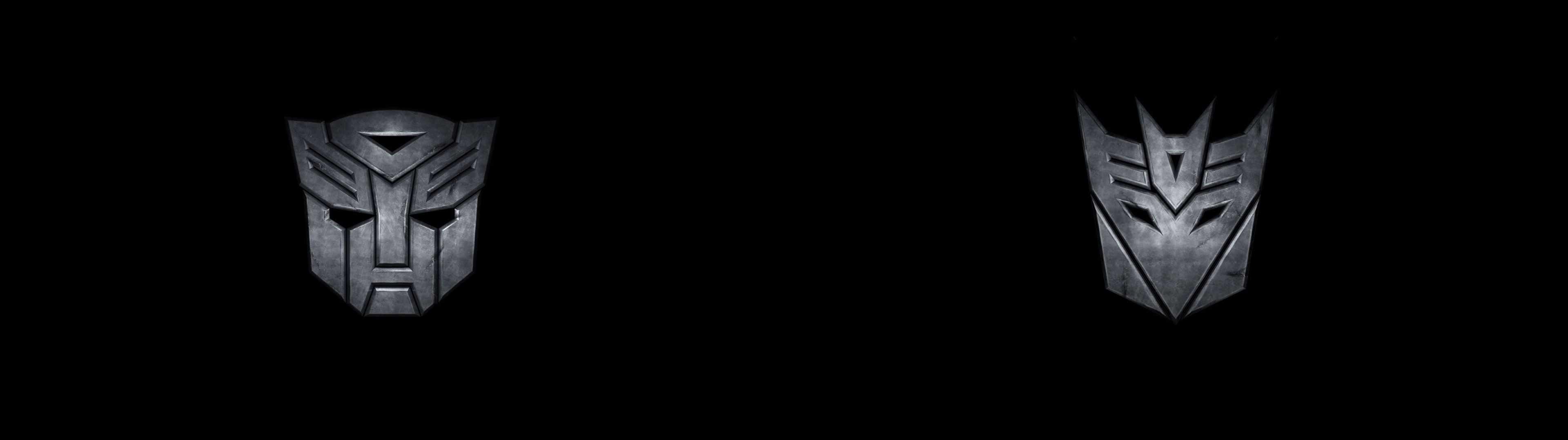 transformers autobot and decepticon symbol dual monitor wallpaper