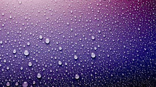 water drops on purple surface uhd 4k wallpaper