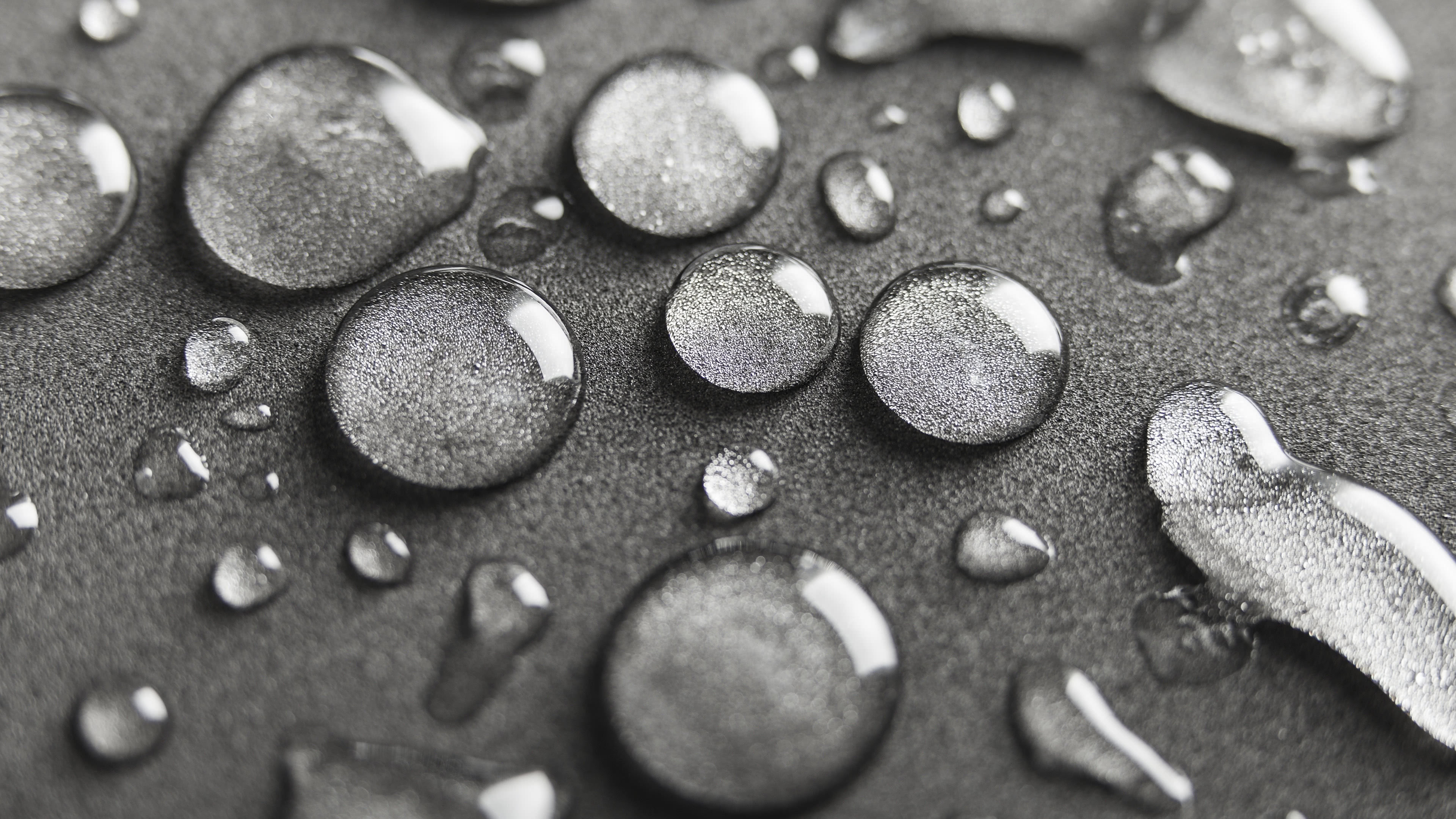 water drops on silver surface uhd 4k wallpaper