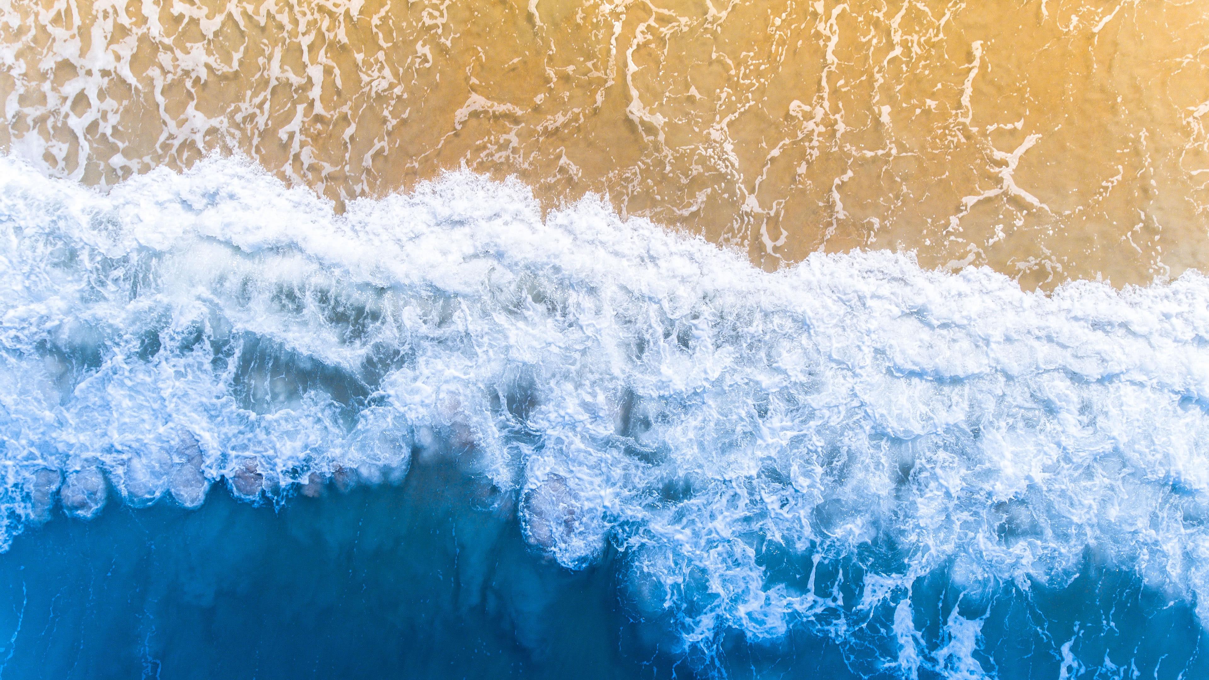ocean sand beach uhd 4k wallpaper